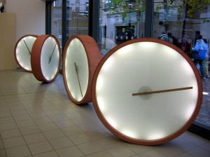 Clocks in Bristol Bus Station, image by Rob Brewer from Bristol England, published under the Creative Commons Attribution Share-Alike 2.0 license