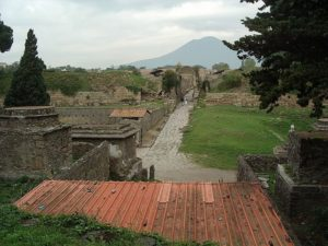 Pompeii with Vesuvius in the background, image published by S?ren Bleikertz under the GNU Free Documentation License, version 1.2 or later